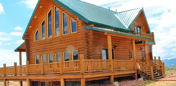 Red Rock Ranch Cabin outside with bush resized